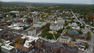 AX151_181 - 6K stock footage aerial video orbiting St Paul's Church, New Hampshire State House, downtown, autumn, Concord, New Hampshire