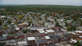 AX151_188 - 6K stock footage aerial video of New Hampshire State House, downtown in autumn, Concord, New Hampshire