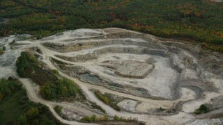 AX152_011 - 6K stock footage aerial video flying by a quarry, colorful foliage in autumn, Bow, New Hampshire
