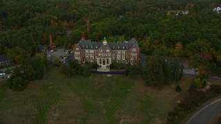 AX152_019 - 6K stock footage aerial video approaching, flying over Mercy Hall, Mount Saint Mary College, autumn, Hooksett, New Hampshire