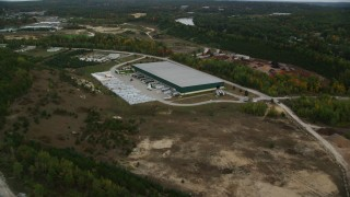 AX152_029 - 6K stock footage aerial video over quarry, approach warehouse building, autumn, Hooksett, New Hampshire