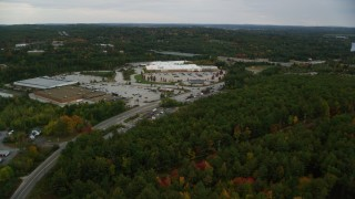 AX152_031 - 6K stock footage aerial video flying over colorful trees, approaching a Target, autumn, Hooksett, New Hampshire