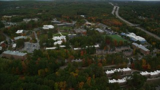 AX152_033 - 6K stock footage aerial video flying over Southern New Hampshire University, pan left, autumn, Hooksett, New Hampshire