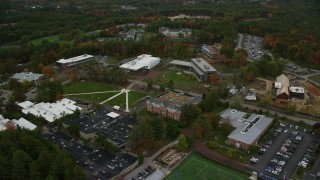 AX152_034 - 6K stock footage aerial video  flying by Southern New Hampshire University, autumn, Hooksett, New Hampshire
