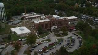 AX152_037 - 6K stock footage aerial video orbiting the Veterans Affairs Medial Center, autumn, Manchester, New Hampshire