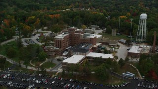 AX152_039 - 6K stock footage aerial video orbiting colorful foliage, Veterans Affair Medical Center, autumn, Manchester, New Hampshire