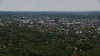 AX152_040 - 6K stock footage aerial video flying by downtown office towers, colorful foliage, autumn, overcast, Manchester, New Hampshire