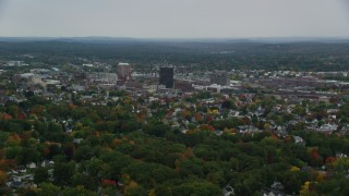 AX152_041 - 6K stock footage aerial video flying by downtown office towers, colorful trees, autumn, Manchester, New Hampshire