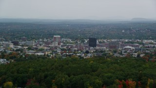AX152_043 - 6K stock footage aerial video flying by office towers, downtown, overcast, autumn, Manchester, New Hampshire