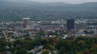 AX152_046 - 6K stock footage aerial video of Downtown towers, City Hall Plaza, Hampshire Plaza, overcast, autumn, Manchester, New Hampshire