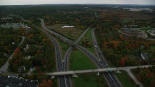 AX152_047 - 6K stock footage aerial video flying over Interstate 93, Interstate 293 interchange, autumn, overcast, Manchester, New Hampshire