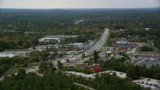 AX152_054 - 6K stock footage aerial video flying by car dealership, strip mall, Nashua Road, autumn, Londonderry, New Hampshire