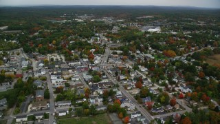 AX152_057 - 6K stock footage aerial video orbiting Broadway, downtown areas, autumn, Derry, New Hampshire