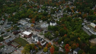 AX152_059 - 6K stock footage aerial video flying over Broadway, colorful foliage, downtown, tilt up, Derry, New Hampshire