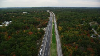 AX152_065 - 6K stock footage aerial video flying over Interstate 93, light traffic, colorful foliage, autumn, Derry, New Hampshire
