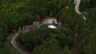 AX152_069 - 6K stock footage aerial video flying away from Searles Castle, trees, autumn, Windham, New Hampshire