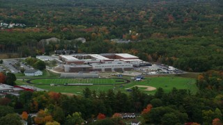 AX152_079 - 6K stock footage aerial video flying by Salem High School, football practice, autumn, Salem, New Hampshire