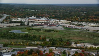 AX152_080 - 6K stock footage aerial video flying by Rockingham Park, colorful foliage in autumn, overcast, Salem, New Hampshire