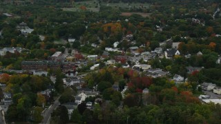 AX152_085 - 6K stock footage aerial video flying by Methuen Fire Department, busy intersection, autumn, Methuen, Massachusetts