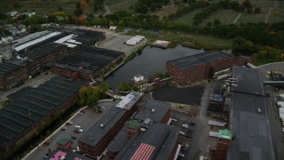 AX152_086 - 6K stock footage aerial video approaching factories, pan right and tilt down, autumn, Methuen, Massachusetts