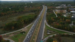 AX152_160 - 6K stock footage aerial video flying over highway lined with fall foliage, autumn, Billerica, Massachusetts