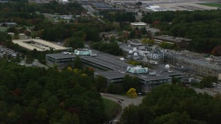 AX152_170 - 6K stock footage aerial video flying by MIT Lincoln Laboratory, autumn, overcast, Lexington, Massachusetts