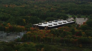 AX152_171 - 6K stock footage aerial video flying by Minuteman High School, colorful foliage, autumn, Lexington, Massachusetts