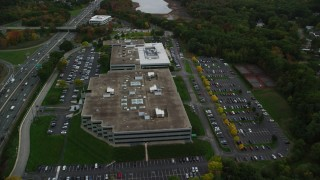 AX152_173 - 6K stock footage aerial video flying over Interstate 95, approaching office buildings, autumn, Waltham, Massachusetts