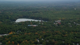 AX152_177 - 6K stock footage aerial video approaching Lake Waban, Green Hall, autumn, overcast, Wellesley College, Massachusetts