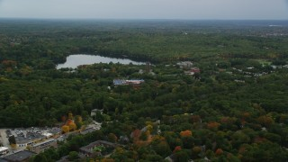 AX152_178 - 6K stock footage aerial video  approaching Lake Waban, Green Hall, autumn, overcast, Wellesley College, Massachusetts