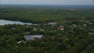 AX152_179 - 6K stock footage aerial video flying by Green Hall, colorful foliage in autumn, Wellesley College, Massachusetts