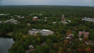 AX152_181 - 6K stock footage aerial video orbiting Green Hall and Tower Court, autumn, Wellesley College, Massachusetts