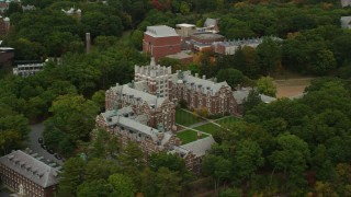 AX152_182 - 6K stock footage aerial video orbiting Tower Court, colorful foliage, autumn, Wellesley College, Massachusetts