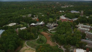 AX152_183 - 6K stock footage aerial video orbiting Wang Campus Center, autumn, Wellesley College, Massachusetts