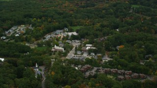 AX152_188 - 6K stock footage aerial video flying by Dover City Hall, small town, autumn, Dover, Massachusetts