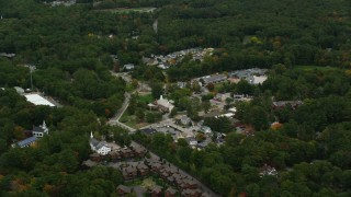 AX152_189 - 6K stock footage aerial video flying by Dover City Hall, small town in autumn, Dover, Massachusetts