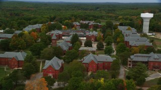 AX152_193 - 6K stock footage aerial video orbiting Medfield State Hospital, colorful foliage, autumn, Medfield, Massachusetts