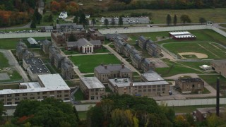 AX152_214 - 6K stock footage aerial video flying by Massachusetts Correctional Institution at Norfolk, autumn, Massachusetts