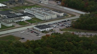 AX152_215 - 6K stock footage aerial video flying by buildings at Massachusetts Correctional Institution Cedar Junction, autumn, Walpole, Massachusetts