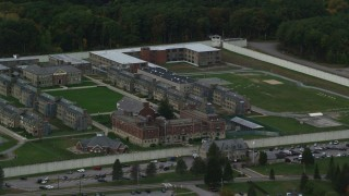 AX152_228 - 6K stock footage aerial video of Massachusetts Correctional Institution at Norfolk and fall foliage,  Massachusetts
