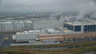 AX153_001 - 6K stock footage aerial video of the Intel manufacturing plant at Intel Ronler Acres Campus and low clouds, autumn, Hillsboro, Oregon
