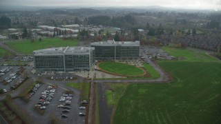 AX153_002 - 6K stock footage aerial video flying over Office Buildings, Tech Company Synopsis Inc, autumn, Hillsboro, Oregon