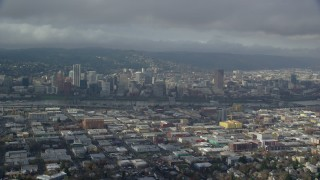 AX153_021 - 6K stock footage aerial video flying over east Portland with a side view of Downtown with clouds, Portland, Oregon