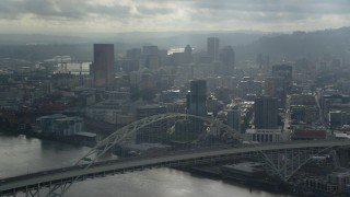 AX153_028 - 6K stock footage aerial video passing by Fremont Bridge toward Downtown Portland, Oregon
