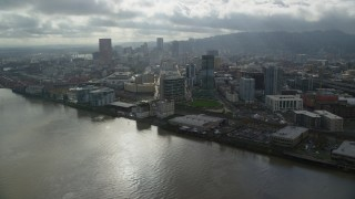 AX153_044 - 6K stock footage aerial video flying over the Willamette River toward Downtown Portland, Oregon