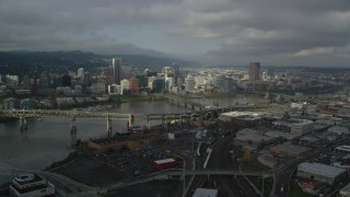 AX153_054 - 6K stock footage aerial video flying over Marquam Bridge toward skyline, Downtown Portland, Oregon