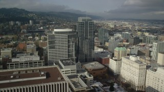 AX153_057 - 6K stock footage aerial video flying over Fox Tower, tracking Park Avenue West Tower, autumn, Downtown Portland, Oregon