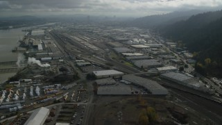 AX153_063 - 6K stock footage aerial video flying over warehouses in an industrial area, Northwest Portland, Oregon