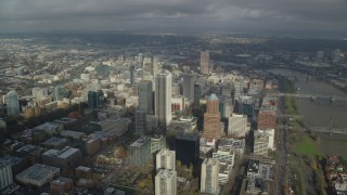 AX153_074 - 6K stock footage aerial video orbiting of skyscrapers in Downtown Portland, Oregon