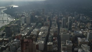 AX153_079 - 6K stock footage aerial video flying by skyscrapers in Downtown Portland, Oregon